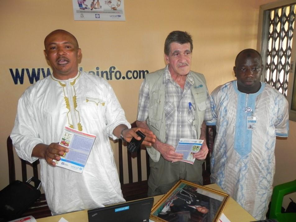 Le président du GOHA, Chérif Mohamed Abdallah, les spécialistes de l'UNICEF Edoardo Casetta et Elhadj Mamadou Barry, lors de la séance de formation tenue le 5 décembre 2014